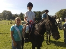 ss-09-victoria-truesdale-on-dillon-winner-of-novice-pony-with-christine-mckee-committee-member